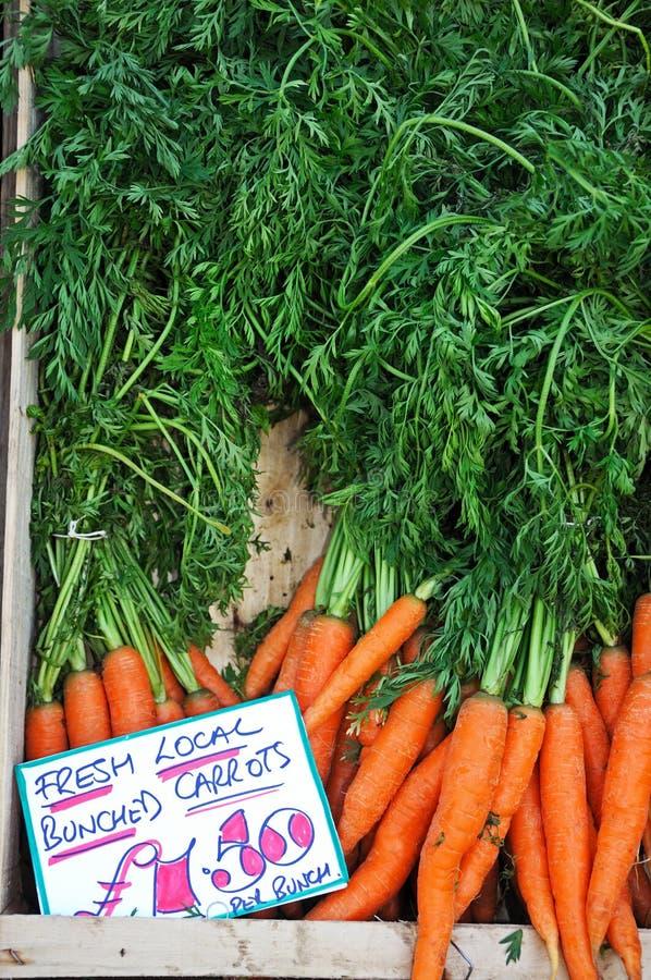 Till salu morötter arkivfoto