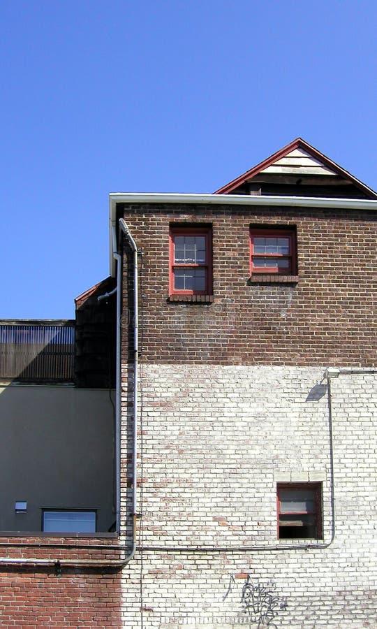 tillbaka byggnad arkivbild