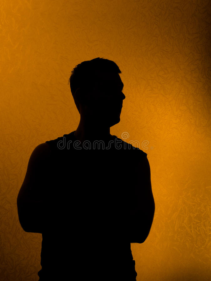 tillbaka förtroende tänd mansilhouette fotografering för bildbyråer