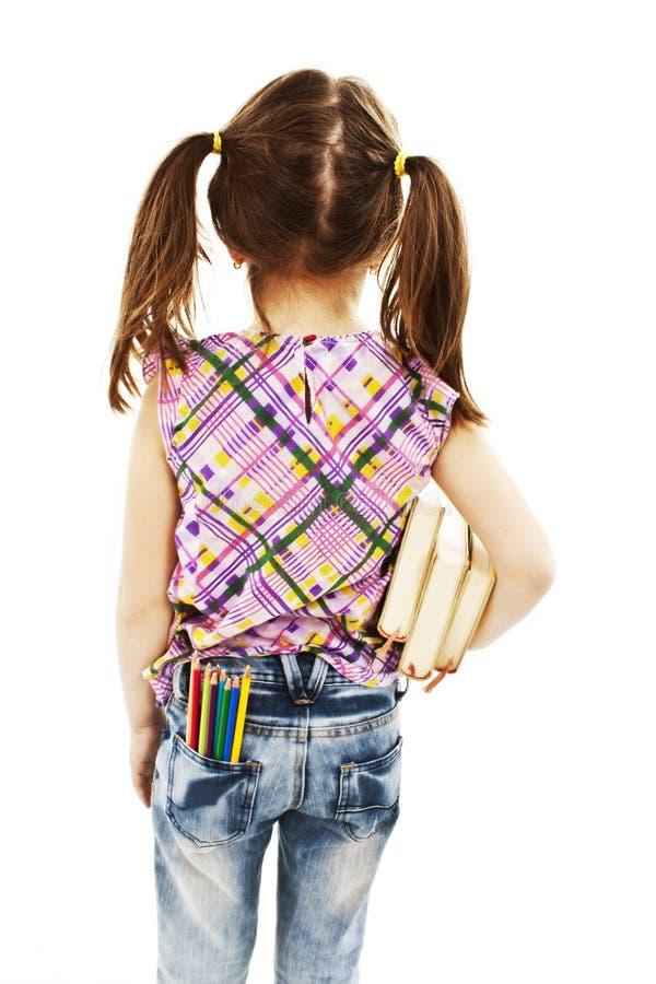 tillbaka flicka som går little skola till arkivbild