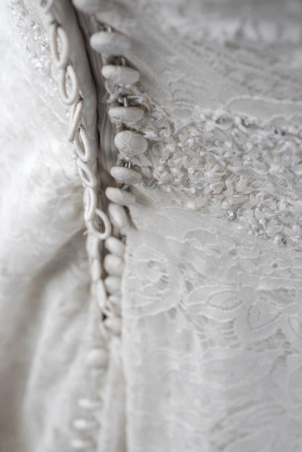 tillbaka klänningbröllop arkivfoto