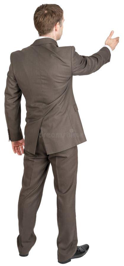 Tillbaka sikt av affärsmannen i dräkten ut som skakar handen royaltyfri foto