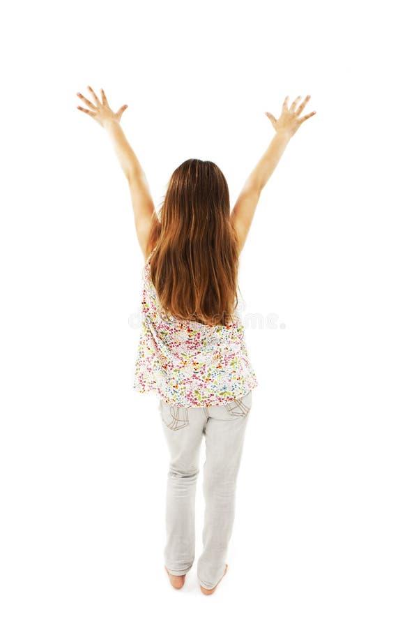 Tillbaka sikt av att dansa den härliga lilla flickan royaltyfria bilder