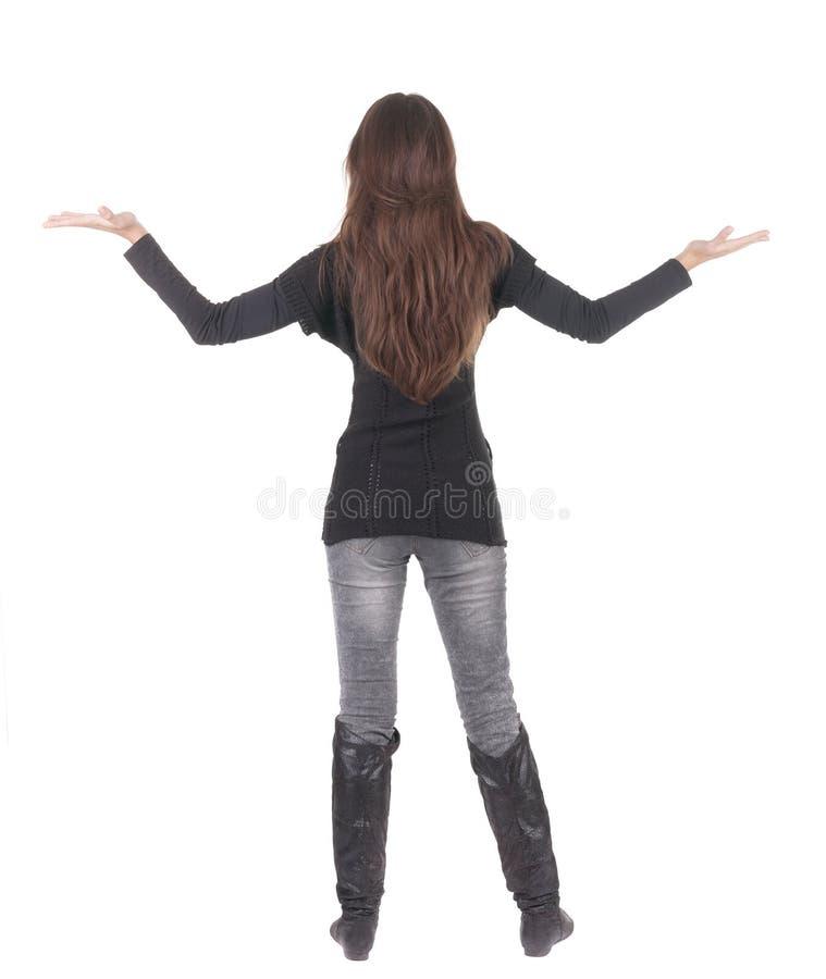 Tillbaka sikt av den lyckliga affärskvinnan i jeans. arkivfoto