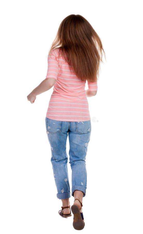 Tillbaka sikt av den rinnande kvinnan Härlig rödhårig manflicka i rörelse arkivbilder