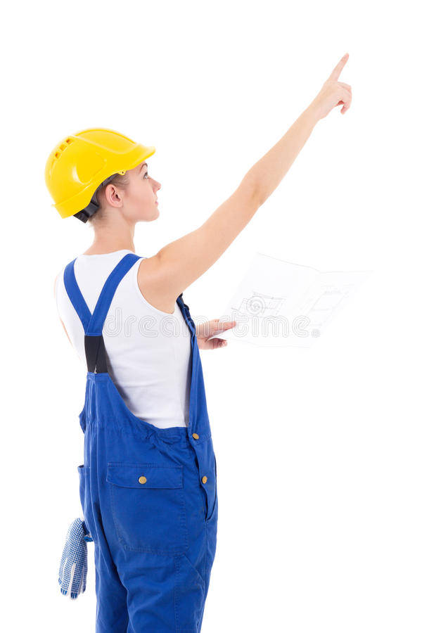 Tillbaka sikt av kvinnabyggmästaren i blåa overaller som rymmer byggande sc royaltyfri bild