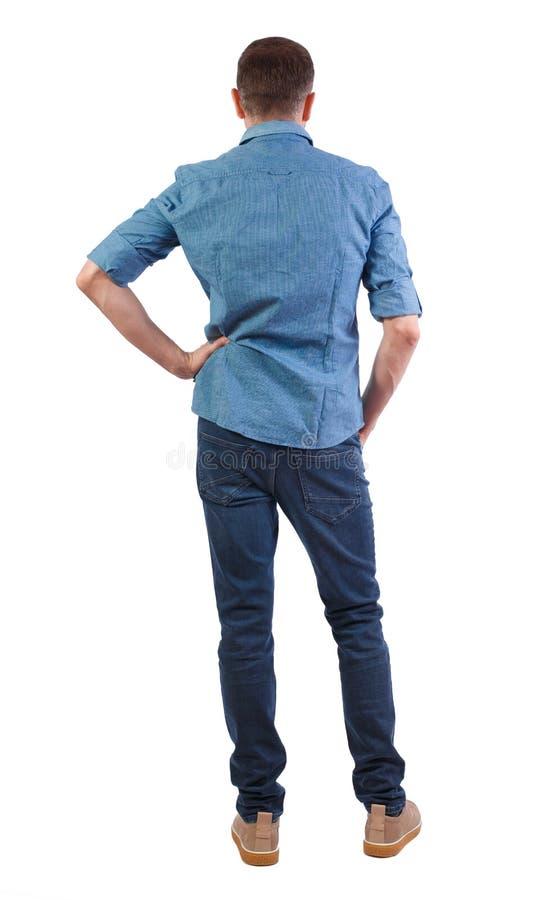 Tillbaka sikt av mannen i mörk jeans royaltyfri foto