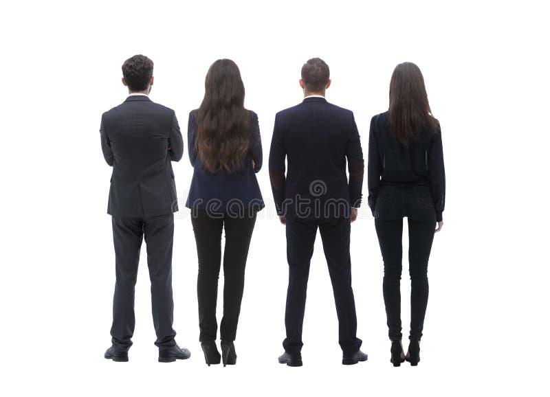 Tillbaka siktsgrupp av affärsfolk isolated rear view white Isolerat över vitbakgrund arkivbild