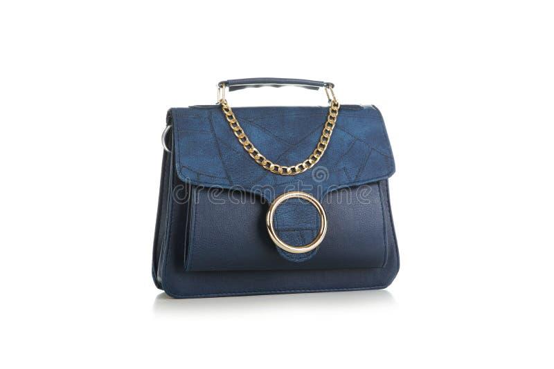 Tillbehör för mode för kvinna` s Blå kvinnahandväska på vit bakgrund royaltyfria bilder