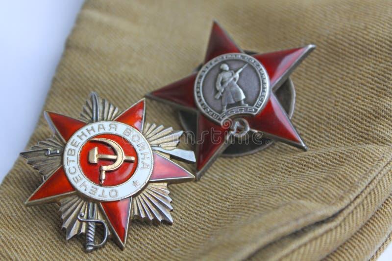 tilldelar ussr Beställningen av ` den stora patriotiska för krig` och röda stjärna`en för `, royaltyfri fotografi