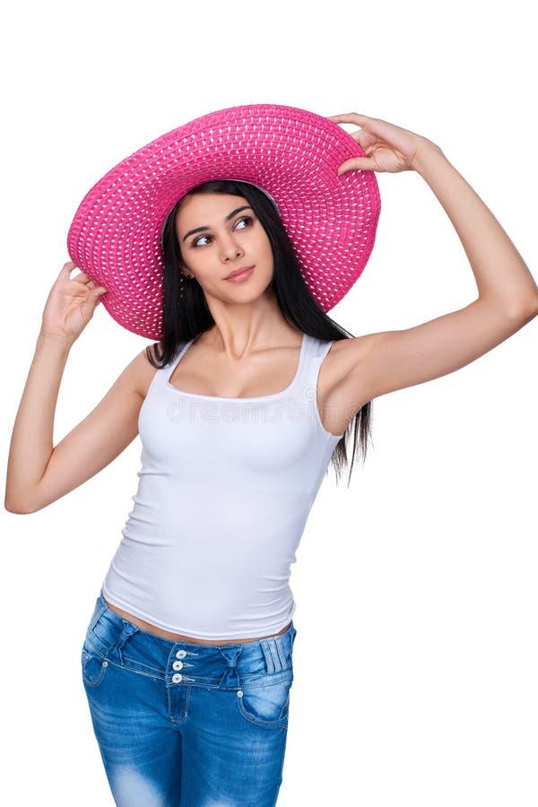 Tillfällig kvinna i rosa sugrörhatt royaltyfria bilder