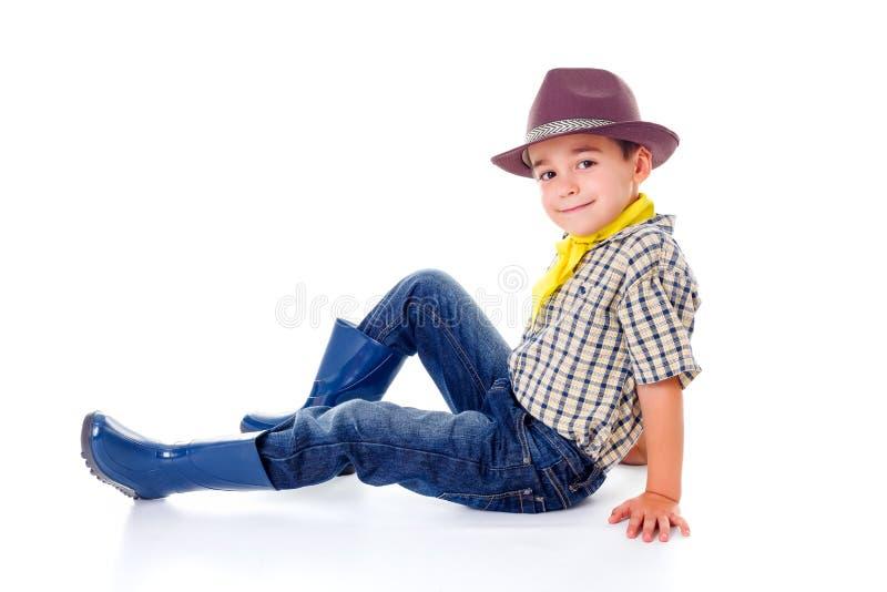 Tillfällig liten cowboy i hatt arkivfoton