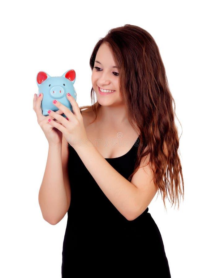 Tillfällig ung flicka med en blå moneybox royaltyfri fotografi