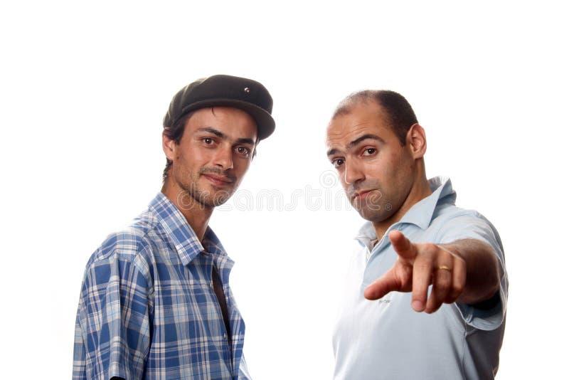 tillfälliga män två barn arkivbild