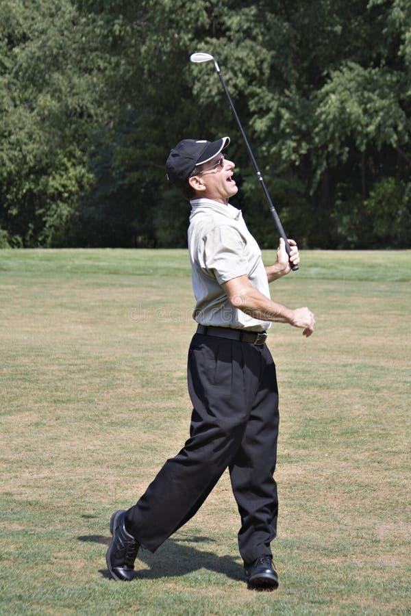 tillfredsställd golfare royaltyfri foto