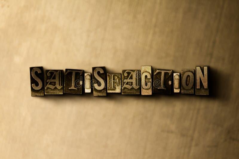 TILLFREDSSTÄLLELSE - närbild av det typsatta ordet för grungy tappning på metallbakgrunden stock illustrationer