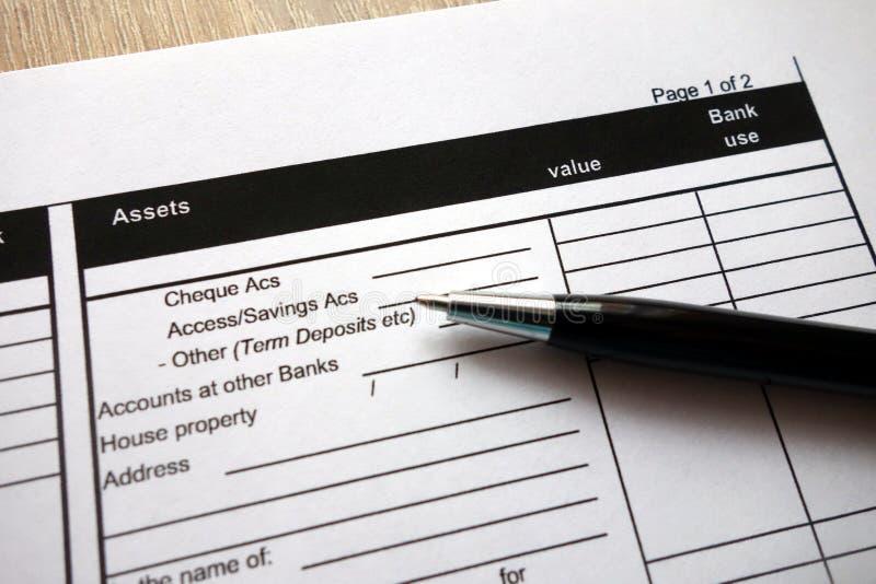 Tillgångöverskrift på krediteringsansökningsblankett arkivfoto