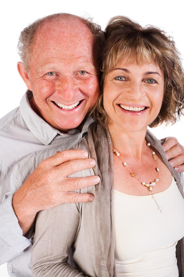 tillgivet behind hans krama gammala fru för man arkivfoto