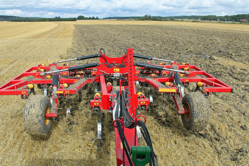 Tilling a Field As Seen from Tractor. Tilling a stubble field with cultivator as seen from the tractor stock photos