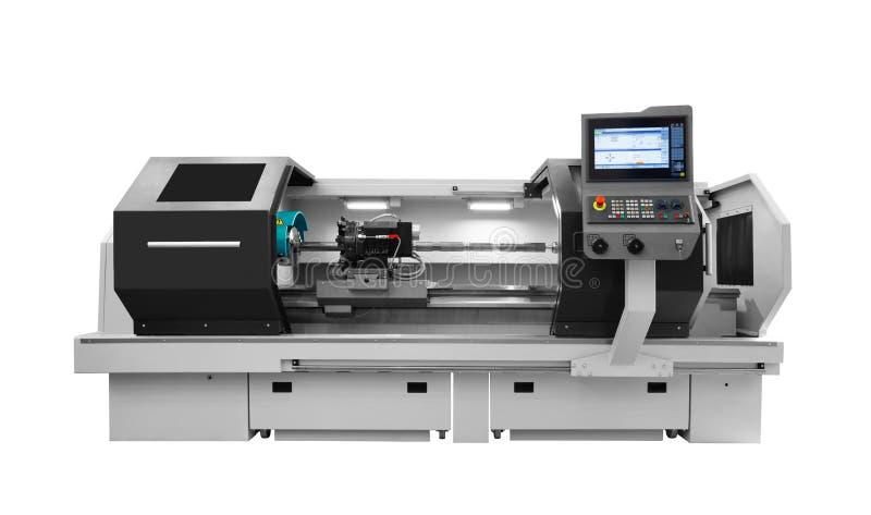 Tillverkande yrkesmässig drejbänkmaskin för CNC som isoleras på en vit bakgrund industriellt begrepp arkivfoto