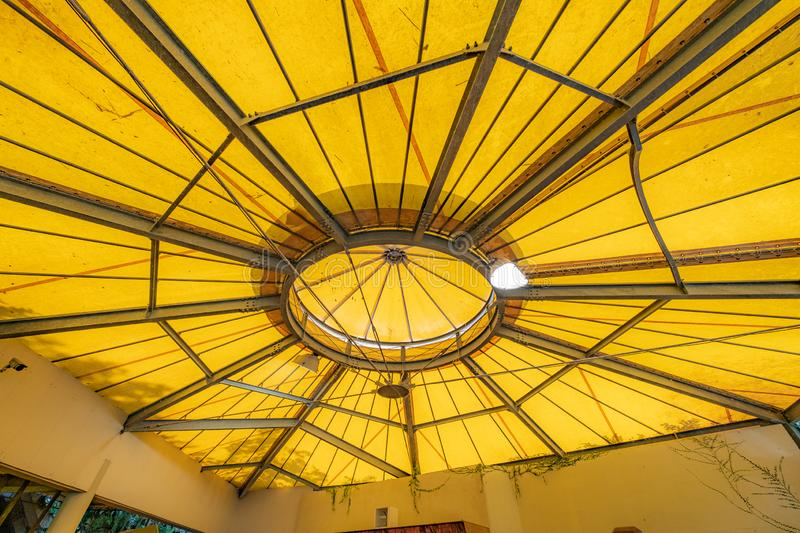 Tilt angle, Under a large outdoor yellow roof top tent with steel frame. Or structure royalty free stock photo