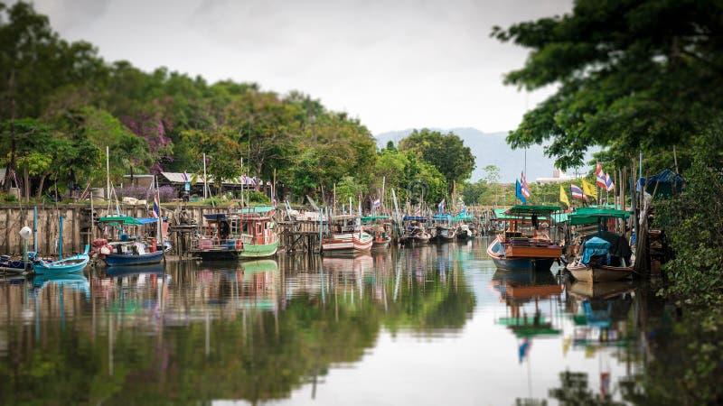 Tilt-shift blur effect. Fishing boats in canal. stock photos