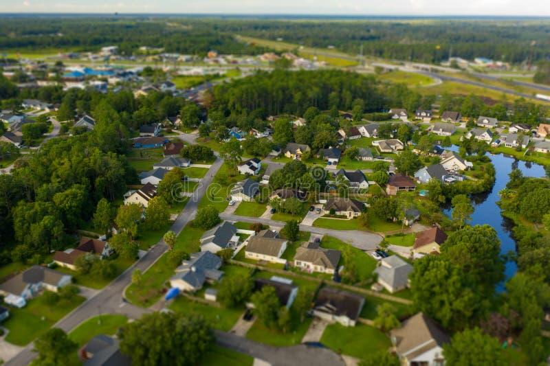 Tilt shift blur miniature rural town houses stock images