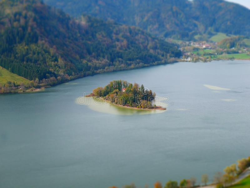 Tilt shift image of the island in lake. Tilt shift image of the island woerth in the lake of schliersee stock images