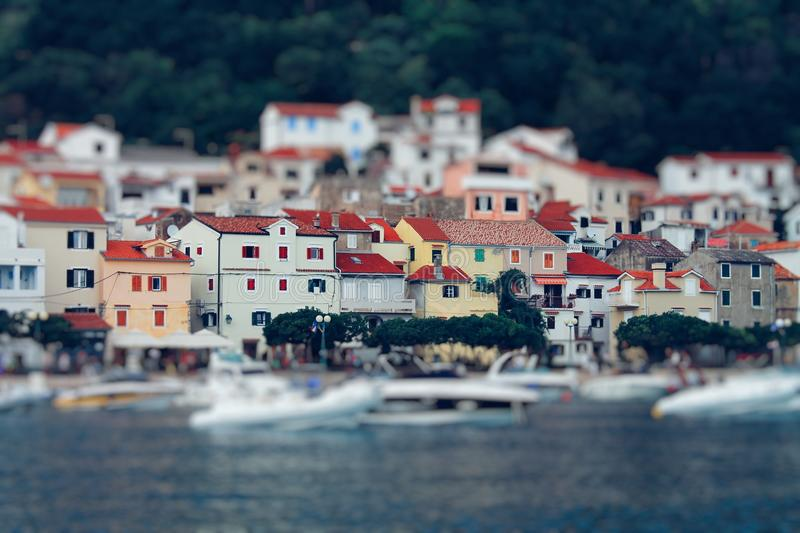 Tilt Shift Lens Photography of Red Roof House Near the Body of Water royalty free stock image