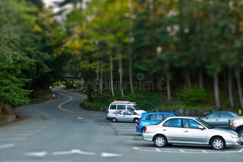 Tilt Shift Parking. Wooded parking lot in tilt shift photography royalty free stock image