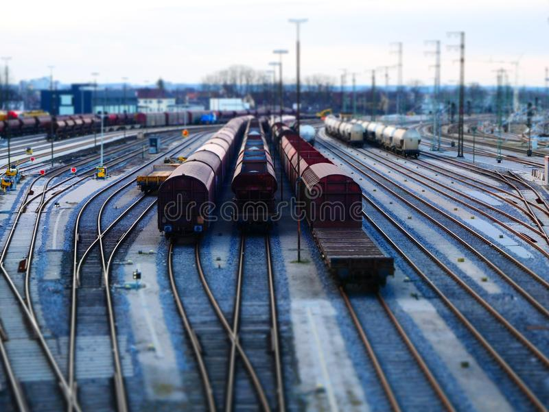Tilt shift railroad infrastructure with goods and passenger transportation system stock photography