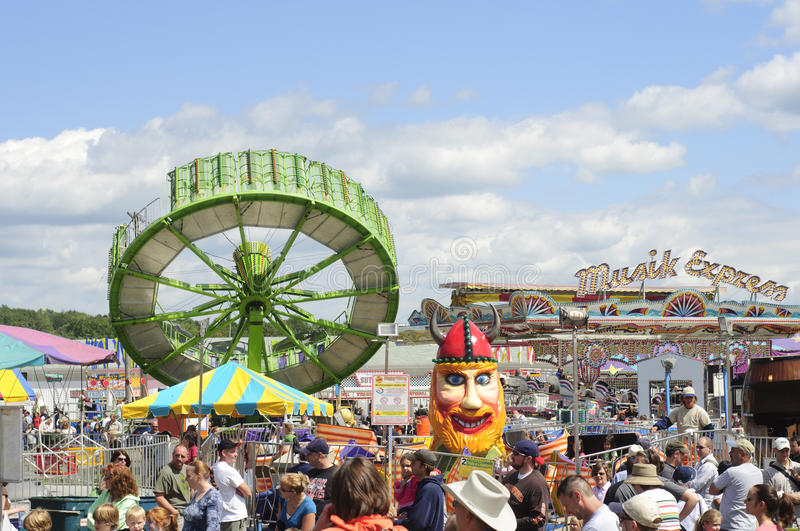 Tilt-a-whirl at fair. Tilt-a-whirl and other amusement rides at the 188th annual Great Geauga County Fair in Burton, Ohio, on September 5, 2010 stock photo