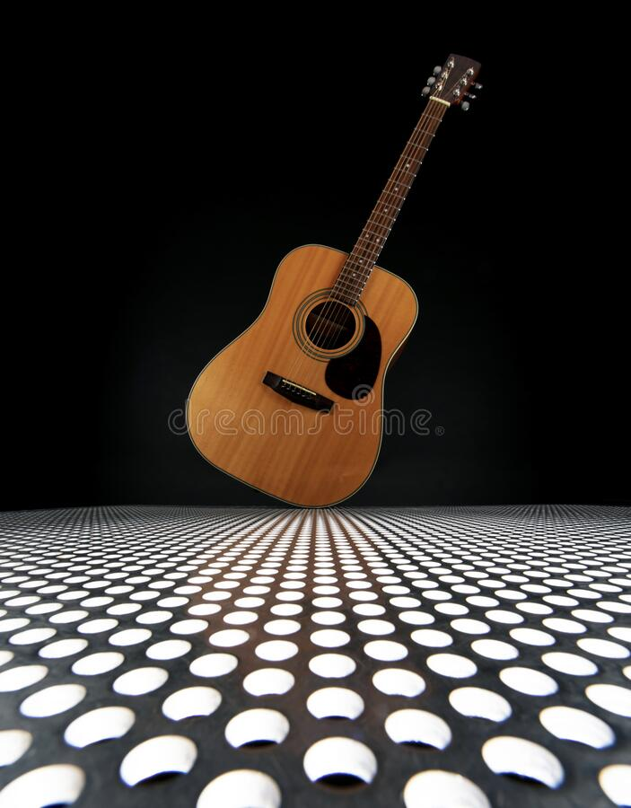 Tilted acoustic guitar stock photography