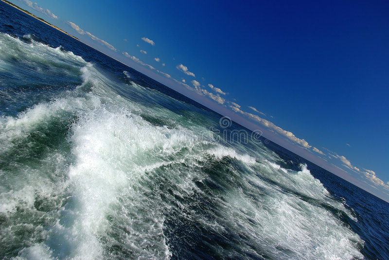 Tilted Boat Wake. A large boat's wake with a tilted horizon royalty free stock images
