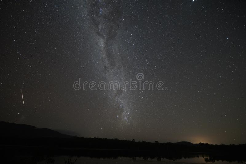 Tilted milky way with meteor in southern hemisphere dark sky. The tilted milky way with meteor in southern hemisphere, Cairns inland, with a meteor on the left stock photography