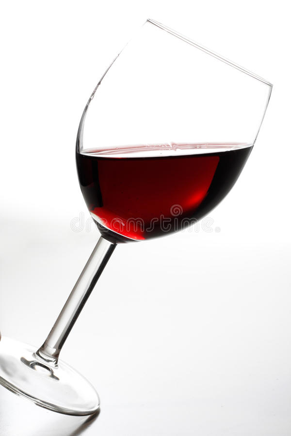 Tilted red wine. A tilted glass of red wine stock photos