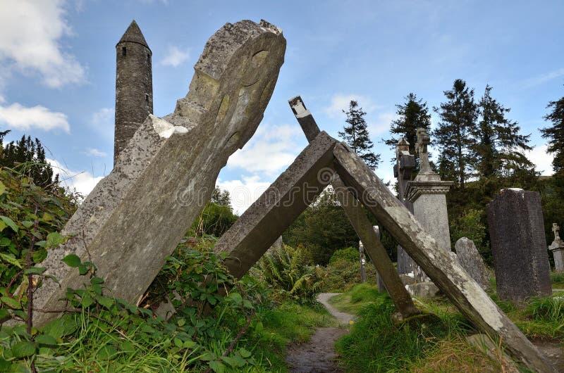 Tilted tombstones. On cementary of Glendalough, Ireland stock image