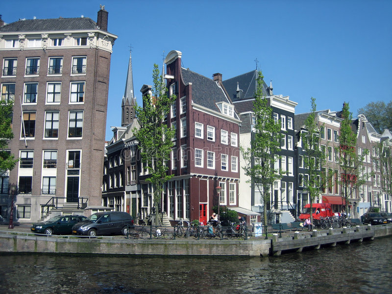 Tilted Town Houses in Amsterdam. Tilted Houses in Amsterdam with pulleys showing royalty free stock photo
