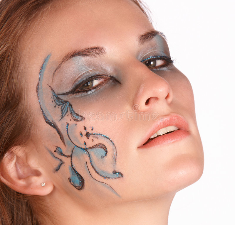 Tilted up. Face tilted up by brunette with fantacy makeup royalty free stock photography