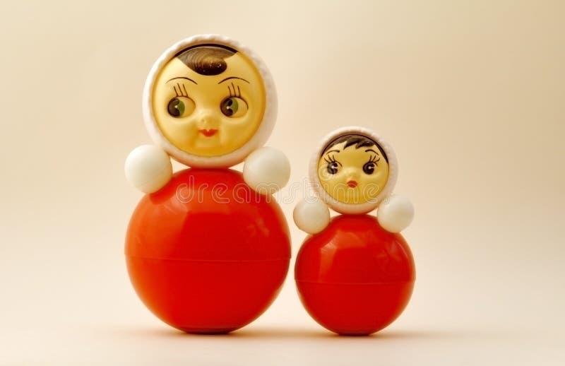 Tilting dolls royalty free stock image