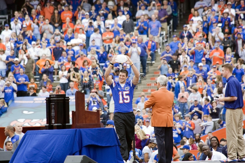 Tim Tebow with NC Trophy stock photos