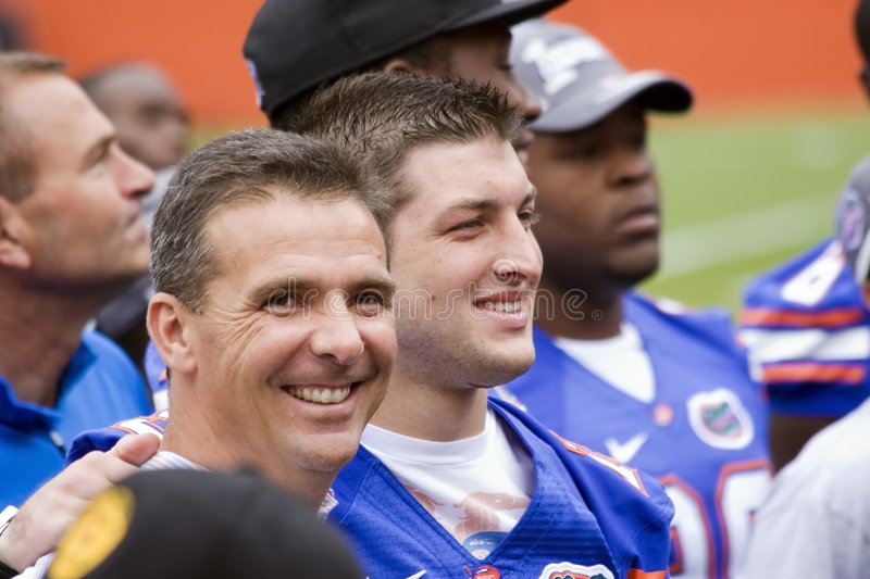 Tim Tebow and Urban Meyer share a smile royalty free stock image