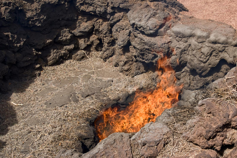 Timanfaya grass turning into fire stock image
