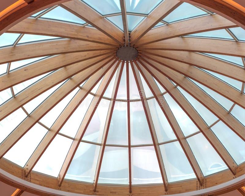 Timber beams of a roof forming a circular skylight stock photos