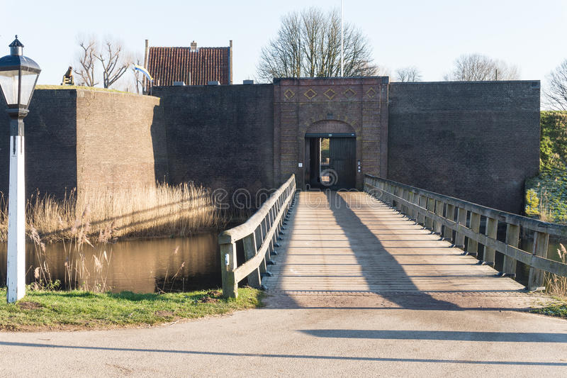The timber bridge that gives entrance to the Fortification Loevestijn in the Netherlands stock images