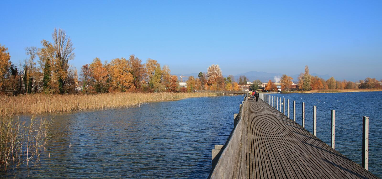 Timber footbridge connecting Rapperswil and Hurden. Lake Obersee royalty free stock images