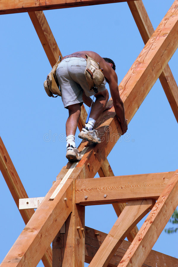 Timber frame construction worker stock photo