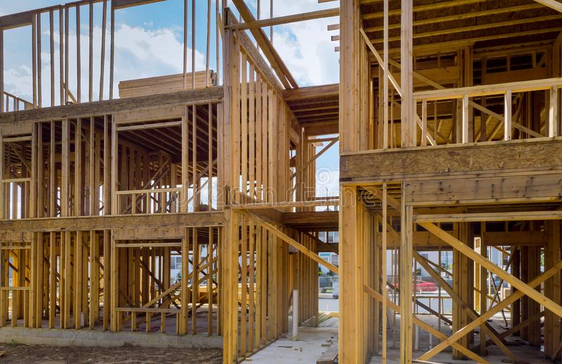 Timber frame house, stick built home under construction New build roof with wooden truss, post and beam framework. royalty free stock image