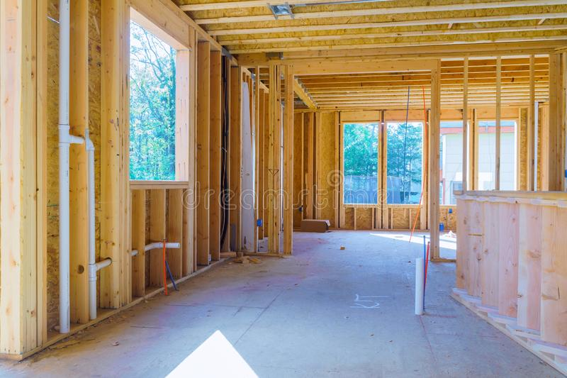 Timber frame house, stick built home under construction with wooden truss, post and beam framework stock image