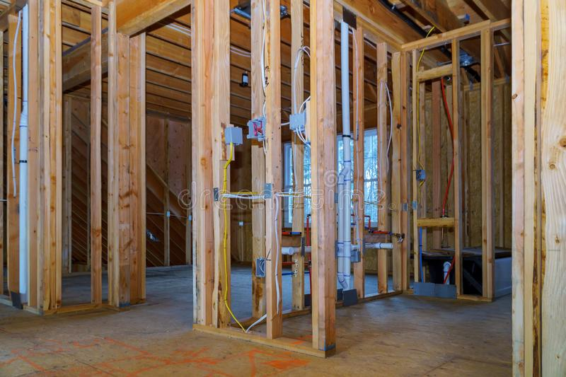 Timber frame house, stick built home under construction with wooden truss, post and beam framework royalty free stock images
